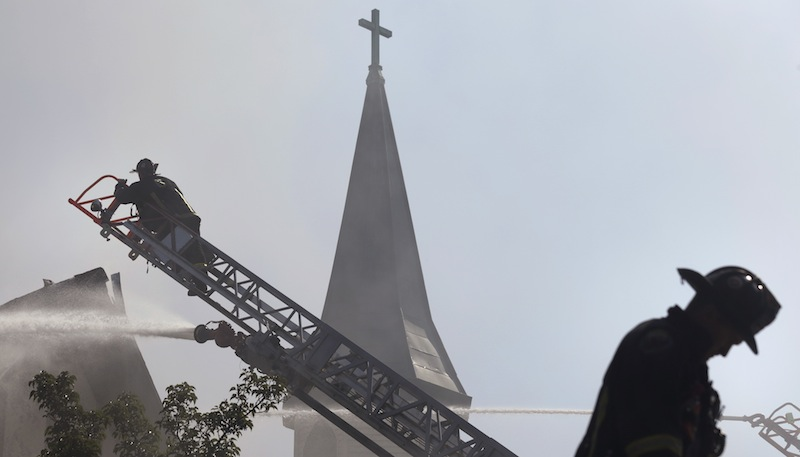 Firefighters battle a five-alarm blaze at St. John the Baptist Albanian Orthodox Church in South Boston on Wednesday.