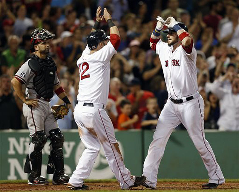 Jarrod Saltalamacchia, right, celebrates his two-run home run that also drove in Mike Napoli (12) as Diamondbacks catcher Wil Nieves, left, looks on in the eighth inning at Fenway Park on Saturday.