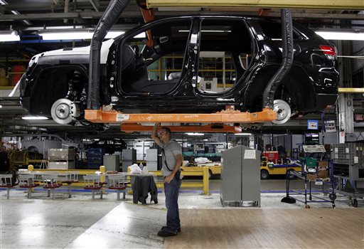 A worker checks the chassis of a vehicle on the assembly line at Chrysler's Jefferson North Assembly plant in Detroit in this May 2013 photo.