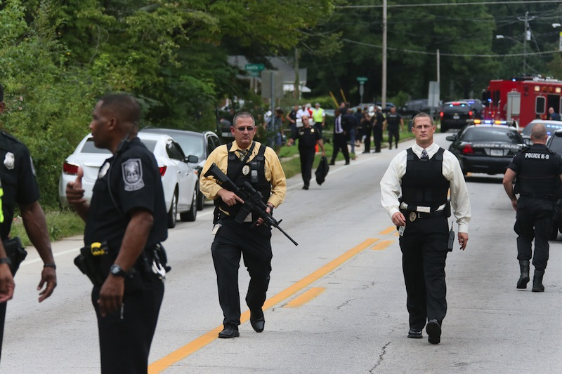 Dekalb County Police SWAT officers prepare at Ronald E. McNair Discovery Learning Academy after reports of a gunman entered the school, Tuesday, Aug. 20, 2013, in Decatur, Ga. A suspect was in custody after reports of gunfire at an Atlanta-area elementary school Tuesday, the school chief said, with television footage showing young students running out the school being escorted by teachers and police. Michael Thurmond told The Associated Press he had no reports of injuries and that all students and teachers are accounted for and safe. (AP Photo/Atlanta Journal-Constitution, Bob Andres)