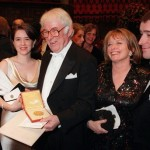 This 1995 photo shows Irish poet Seamus Heaney, center, displaying his Nobel literature prize medal, surrounded by his family.