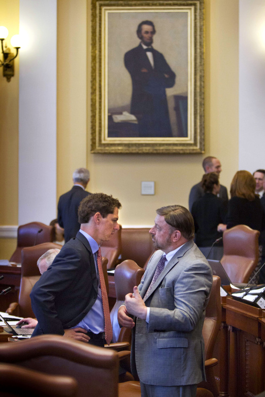Senate president Justin Alfond, left, confers with Sen. John Cleveland, D-Androscoggin County, in the Maine Senate on Thursday at the State House in Augusta, when lawmakers returned for a special session to vote for a $149.5 million bond package slated for the November ballot.