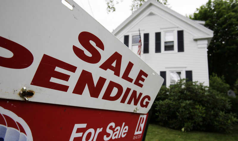In this 2011 file photo, a sale pending sign is set outside a house in Bath, Maine. Sales of existing single-family homes in Maine surged more than 31 percent in July 2013 over the same month last year, outpacing strong gains in both the Northeast and nationally for the same period. (AP Photo/Pat Wellenbach)