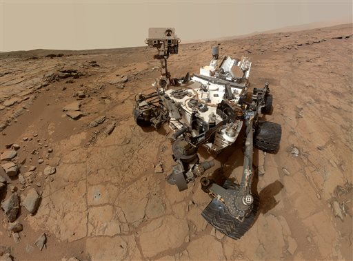 This photo released by NASA shows a self-portrait taken by the rover Curiosity in Gale Crater on Mars. Measurements of the Martian air by the rover have found that it's mostly made of carbon dioxide with traces of other gases.