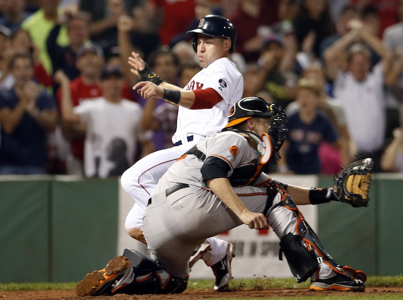 Jacoby Ellsbury slides into home to score on a single by Dustin Pedroia in the seventh inning at Fenway Park on Wednesday.