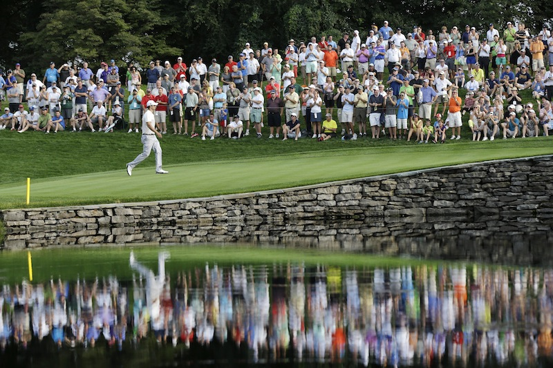 Adam Scott, of Australia, walks to the 15th green during the first round of the PGA Championship golf tournament at Oak Hill Country Club, Thursday, Aug. 8, 2013, in Pittsford, N.Y. (AP Photo/Patrick Semansky)