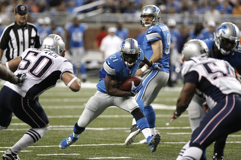 Detroit running back Reggie Bush looks for running room against the New England Patriots on Thursday.