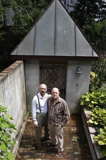 On Monday, July 29, John Gacher, 61, left, and Federico Santi, 66, right, both of Newport , R.I., in front of a garden shed at their home. The couple planned to turn their civil union into a marriage Thursday morning at Newport City Hall. (AP Photo/Steven Senne)