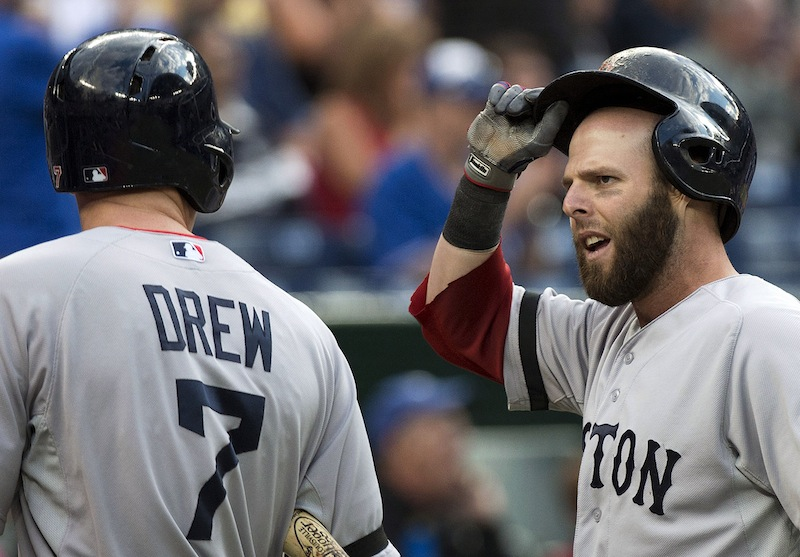 Boston Red Sox second baseman Dustin Pedroia, right, reacts to his teammate Stephen Drew after Pedroia was tagged out at home plate against the Toronto Blue Jays on Thursday in Toronto.