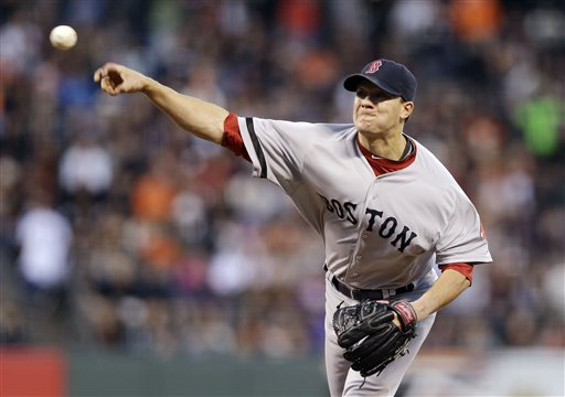 Boston Red Sox pitcher Jake Peavy delivers a pitch during a game against the Giants on Tuesday in San Francisco. Thanks to a payroll drop from about $173 million to about $150 million this season, the Red Sox have had the flexibility to add free agents and to acquire right-hander Peavy at this year's trade deadline.