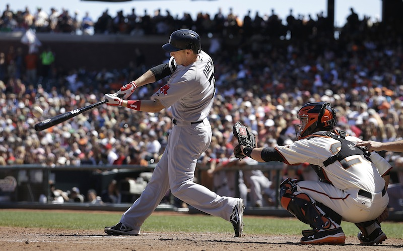 Stephen Drew hits a three-run home run off San Francisco Giants pitcher Michael Kickham during the seventh inning in San Francisco on Wednesday.