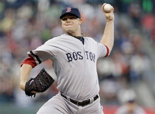 Boston Red Sox starting pitcher Jon Lester throws a pitch during Monday's game against the Giants in San Francisco.