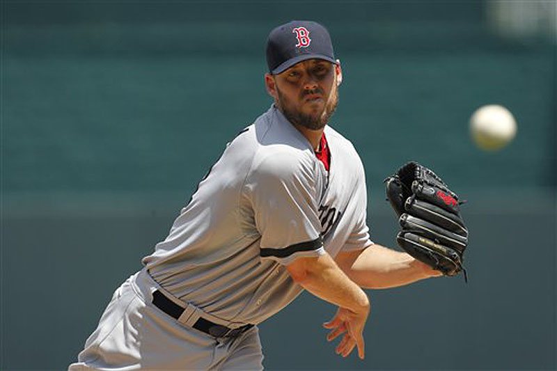 Boston Red Sox pitcher John Lackey warms up in the first inning of Sunday's game against the Kansas City Royals.