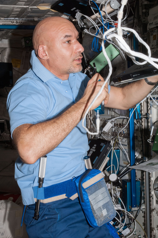 European Space Agency astronaut Luca Parmitano speaks in a microphone while working in the Columbus laboratory of the International Space Station.