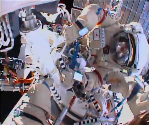 In this image from video made available by NASA, cosmonauts Fyodor Yurchikhin and Aleksandr Misurkin participate in a spacewalk outside the International Space Station on Thursday.
