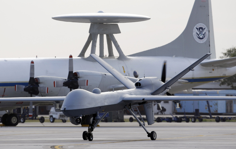 A Predator B unmanned aircraft taxis at the Naval Air Station in Corpus Christi, Texas. Three U.S. drone strikes killed 12 suspected al-Qaida militants Thursday, a Yemeni military official said, as the Arab nation is on high alert against terrorism.