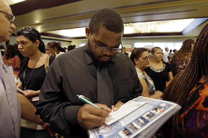 Job seeker Kelsey Devoe, of Miramar, Fla., fills out a contact form at a job fair in Miami Lakes, Fla. Employers hired an average of 4.3 million people a month this year through June, well below the 2006 monthly average of 5.3 million. As a result, net job growth is still subpar.