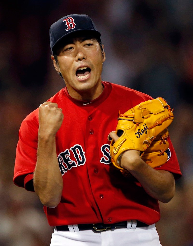 Red Sox closer Koji Uehara celebrates another save after retiring all four batters he faced Friday night in a 4-3 win over the White Sox.