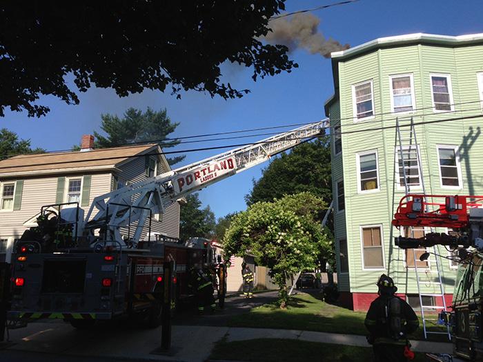 Portland firefighters work to contain a fire in an apartment building at 96 Whitney Ave. on Thursday. They determined that the cause of the fire was the furnace. There were no injuries.
