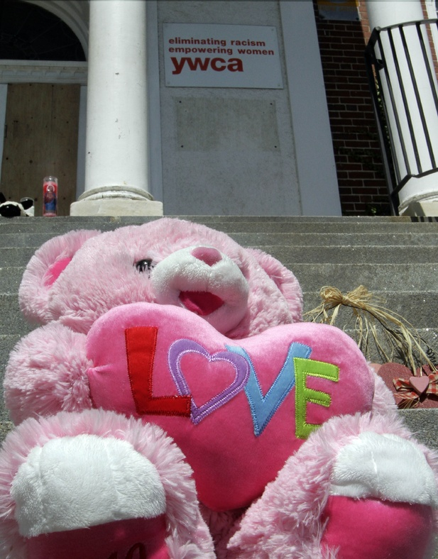 A stuffed bear sits on the steps of the YWCA Monday in Manchester, N.H., a day after 9-year-old Joshua Savyon was shot and killed by his father, who then killed himself.