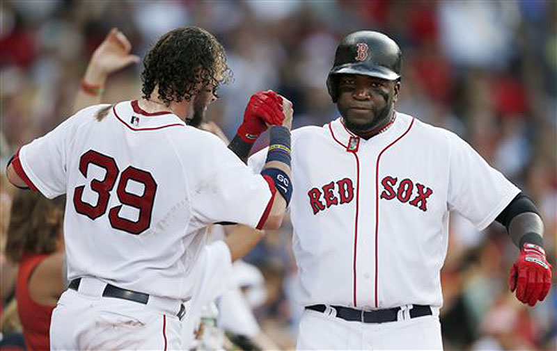 David Ortiz is congratulated by Jarrod Saltalamacchia after hitting a home run in the seventh inning Saturday, helping the Red Sox end a three-game losing streak.