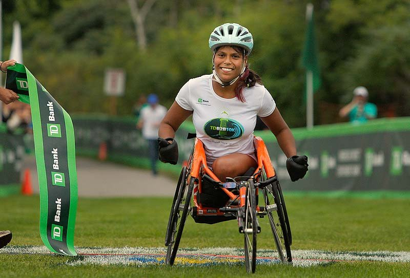 "Christina Kouros might have been the only woman in the wheelchair division, but she posted her best time on her hometown course. ""My town knows I do my best,"" she said."