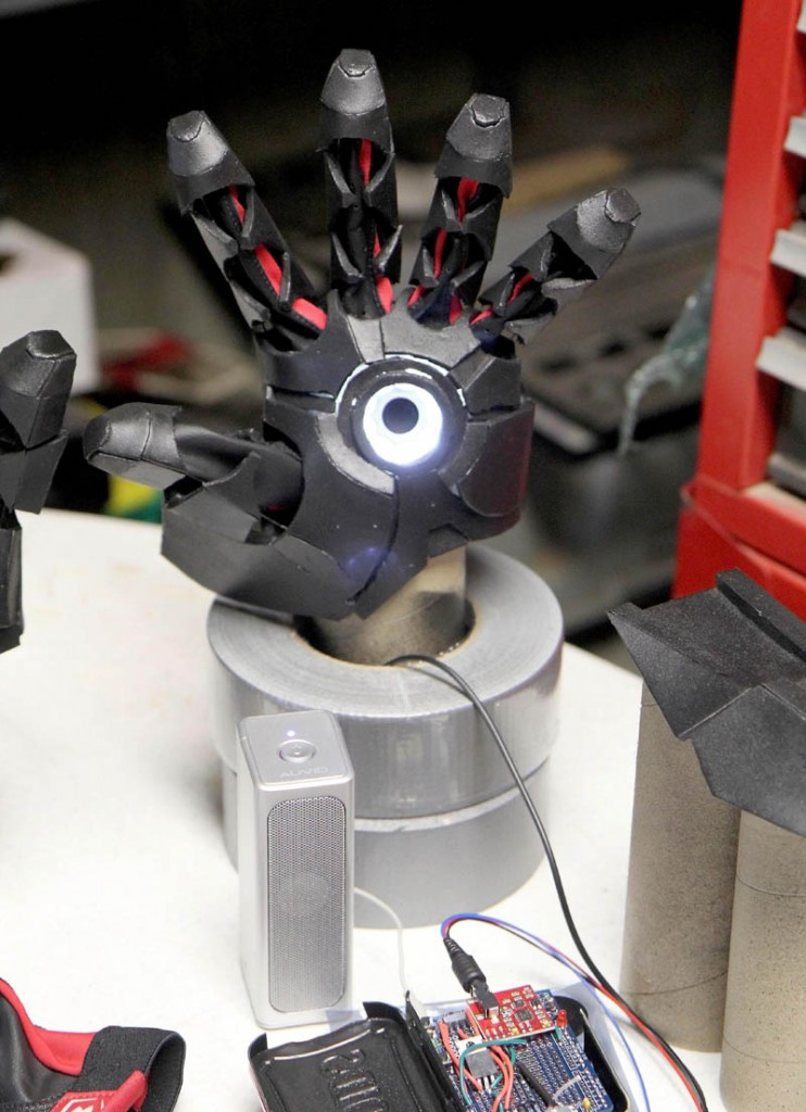 A hand with a bionic repulsor lights up in Thomas Lemieux's workshop, in the basement of his Oakland home, recently.