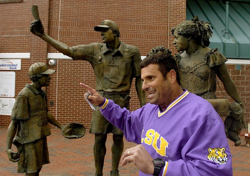 "Glenn Cecchini, father of Sea Dogs third baseman Garin Cecchini, remarks on the ""American Baseball Family"" sculpture at Hadlock Field in Portland recently. ""I don't get it,"" he said ""Who are these people?"""