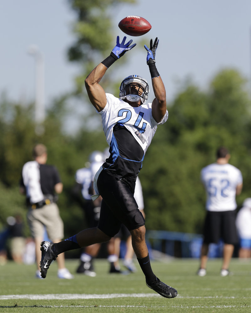 Defensive back Chris Hope of the Detroit Lions pulls down a pass Wednesday during a training-camp drill at Allen Park, Mich.
