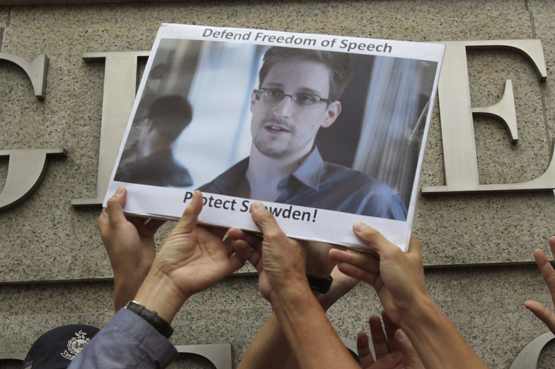 Supporters hold up a poster of Edward Snowden during a demonstration in Hong Kong last June. The former National Security Agency contractor is considered a hero by some.