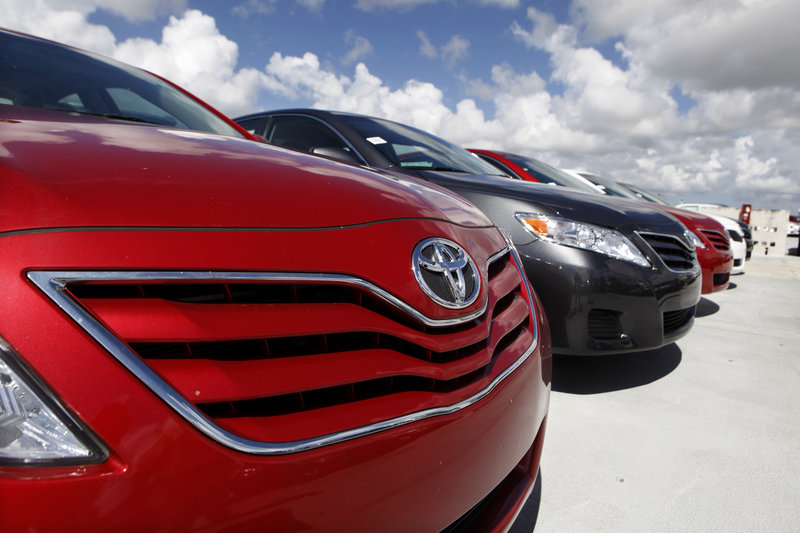 A Toyota Camry LE sits on the lot at Kendall Toyota in Miami. General Motors, Ford, Chrysler, Toyota and Nissan all reported double-digit sales gains in July 2013, signs that U.S. auto sales will remain strong into the second half of the year.