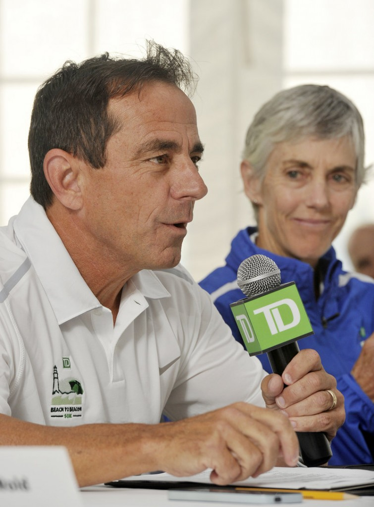 Race director Dave McGillivray addresses the media Friday. At right is race co-founder Joan Benoit Samuelson.