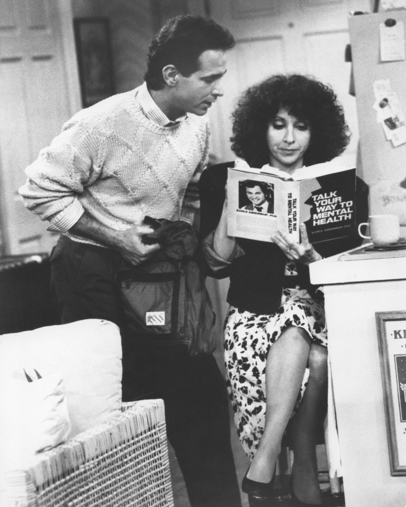 "Roxie, played by 1965 Deering High School graduate Andrea Martin, studies up on group therapy with her TV show husband, Mitchell Laurance, during a 1987 episode of ""Roxie"" on the CBS Television Network."