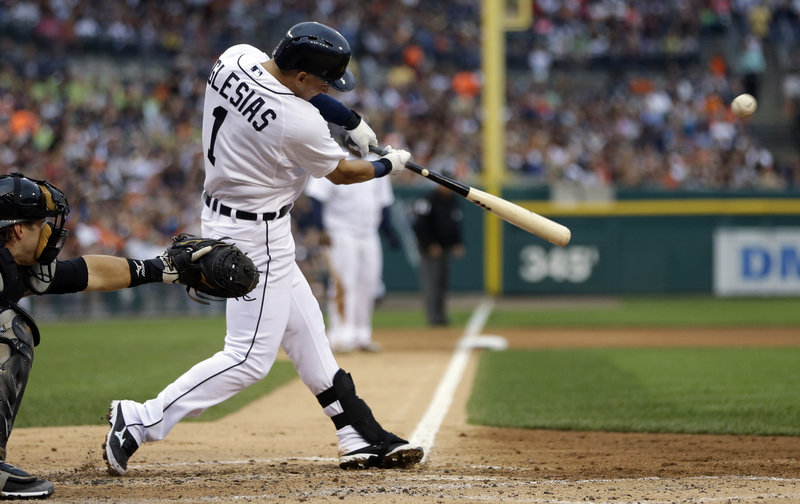 Detroit's Jose Iglesias drives home Prince Fielder from third base during fourth-inning action of Friday's Tigers-Chicago White Sox game in Detroit.