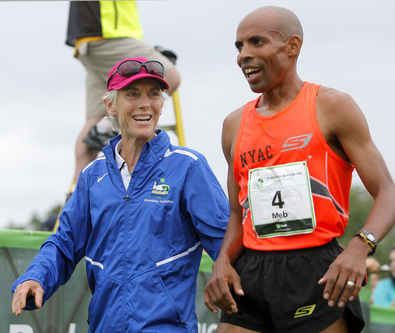 Race founder and former Olympic marathon champion Joan Benoit Samuelson talks with American elite runner Meb Keflezighi after Saturday's race.