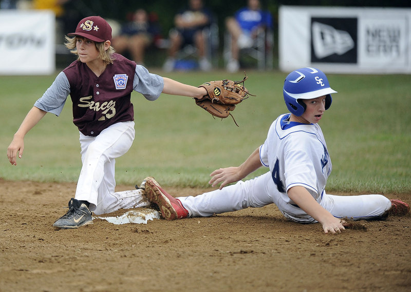 Timmy Smith of Saco has the ball and the bag, forcing Zeke O'Connell of Newton, Mass., at second base.