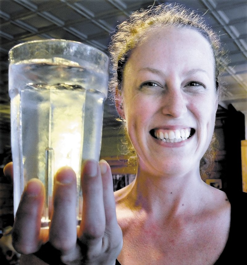 "Amber Strickland holds a glass full of water from the Bingham water supply at Thompson's restaurant recently. Strickland said she has lived all over New England and Bingham water is the best tap water she has had. ""We have never heard a complaint from customers,"" Strickland said."