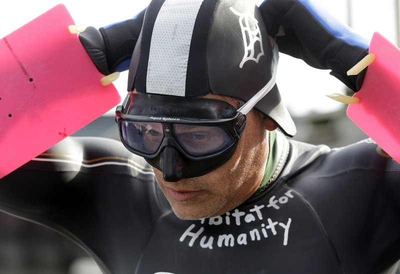 Jim Dreyer adjusts his mask before attempting a 22-mile lake crossing. The swim, to benefit Habitat for Humanity, is expected to take 30 hours and end at Detroit's Belle Isle.