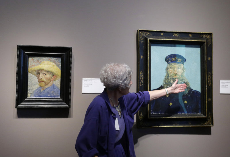 "Docent Lea Schelke points out details in ""Portrait of Postman Roulin"" by Vincent Van Gogh recently at the Detroit Institute of Arts."
