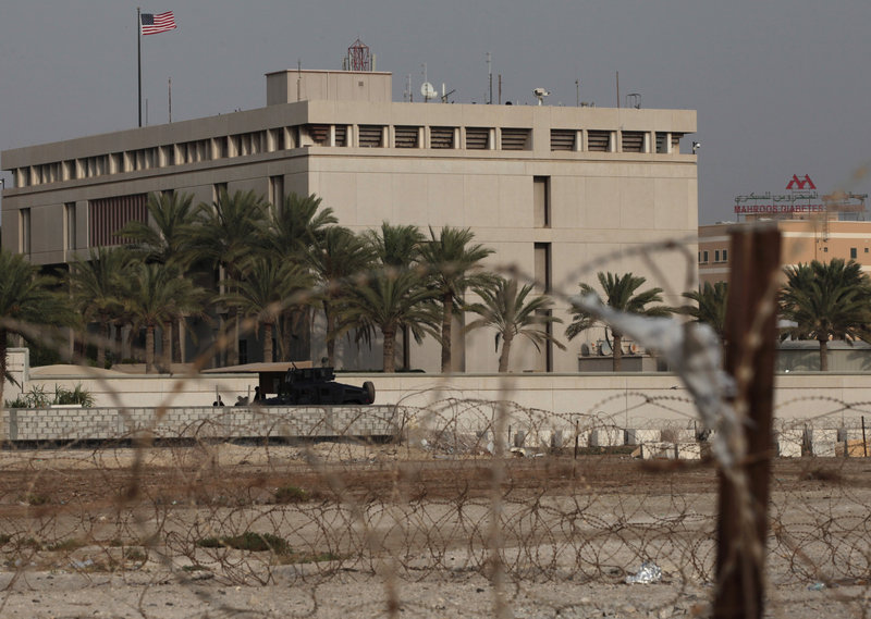 A Bahraini armored vehicle and its personnel reinforce U.S. embassy security just outside of a gate to the building, surrounded in barbed wire, in Manama, Bahrain, on Sunday, following the threat of an attack by al-Qaida.