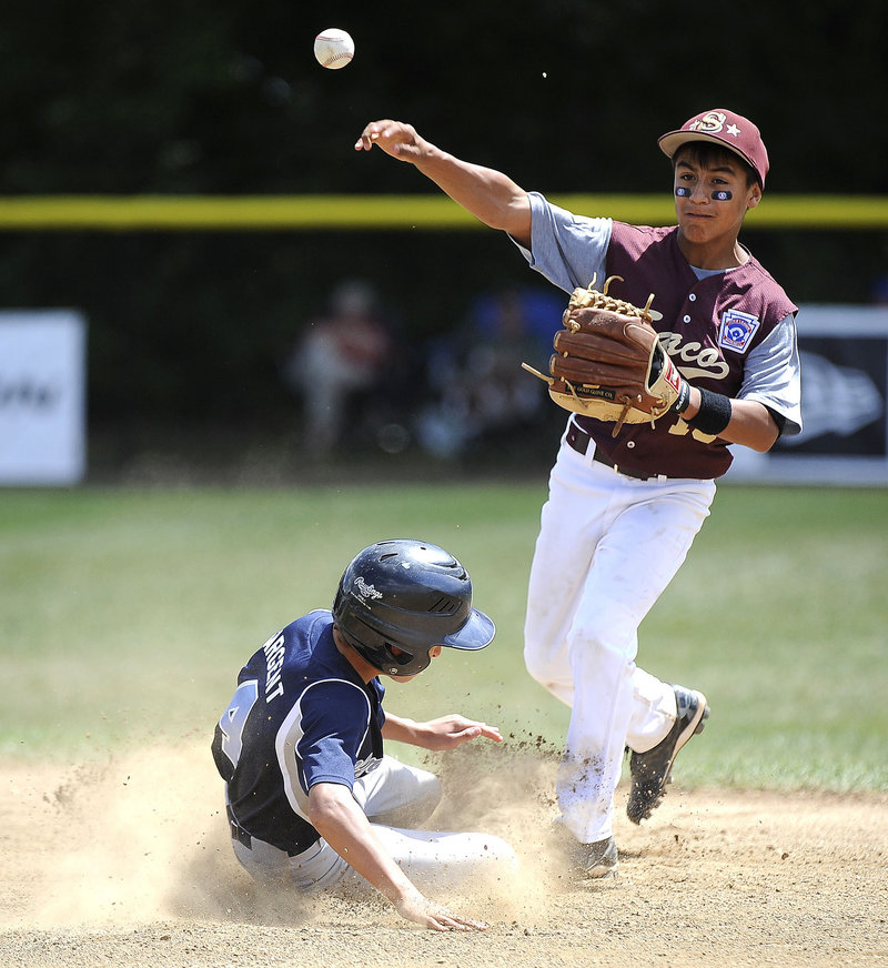 Anthony Bracamonte of Saco forces Ryan Sargent of South Burlington, Vt., at second base Tuesday during their Little League regional game. South Burlington reached the semifinals and Saco still harbors hopes.