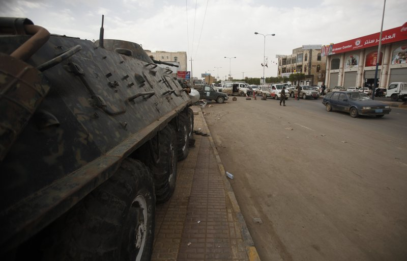 A police armored personnel carrier is stationed at a checkpoint on the road leading to the Sanaa International Airport in Yemen. The United States told its citizens in Yemen on Tuesday to leave immediately. After warnings of potential attacks, Washington shut diplomatic missions across the Middle East.
