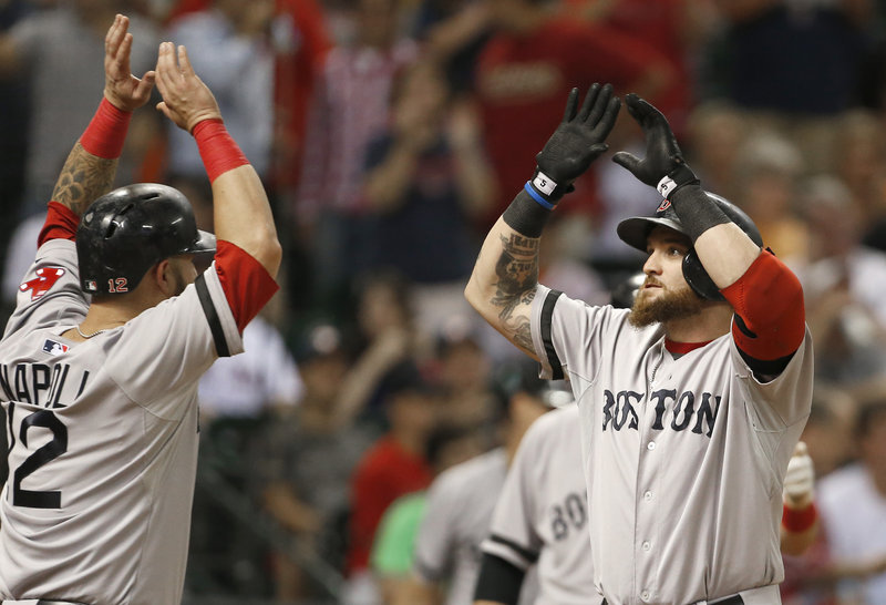 Jonny Gomes of the Boston Red Sox, right, is welcomed by Mike Napoli after hitting a three-run homer Tuesday night against Houston. Boston won 15-10.