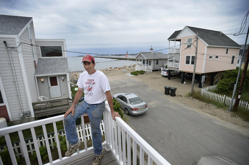 Dean Coniaris of Camp Ellis has a view of the jetty and Saco Bay from his porch on Eastern Avenue. He remembers the 1978 winter nor'easter that brought down as many as 18 houses along the shore.