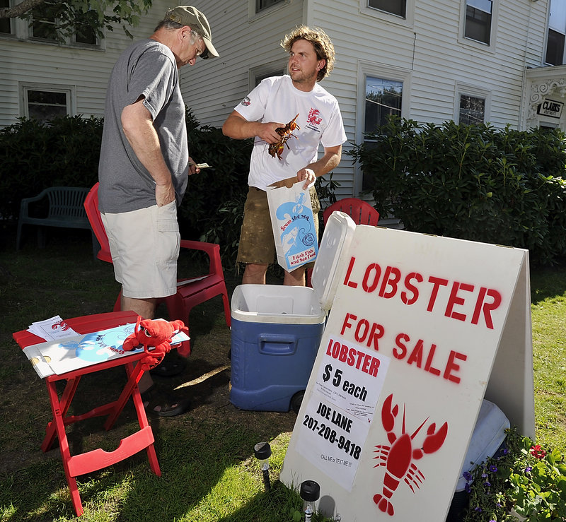 Lobsterman Joe Lane bypasses dealers and sells his catch directly to customers. He offered pound to pound-and-a-quarter lobsters at $5 each Tuesday from his home in Damariscotta.