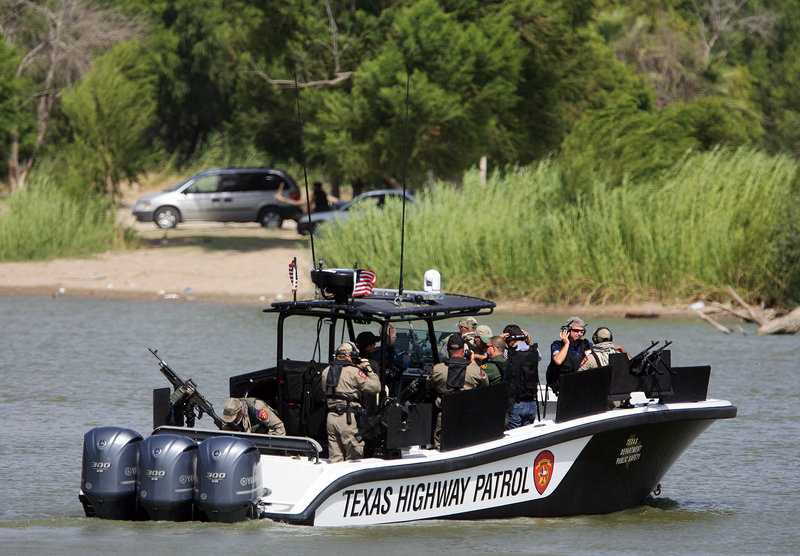 Members of Congress ride on a border security boat Tuesday in Mission, Texas. A reader urges stronger action to stop the flow of illegal immigrants to this country.