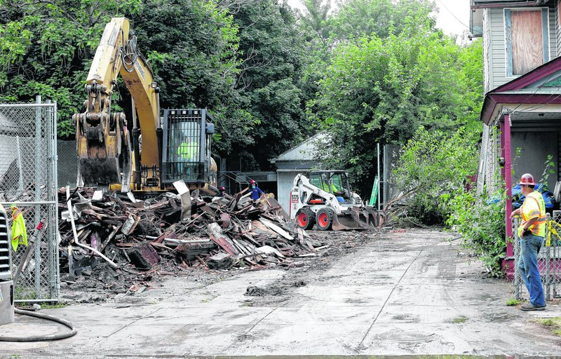The Cleveland home of Ariel Castro is razed Wednesday as part of a plea deal that also led to his being sentenced to life in prison plus 1,000 years.