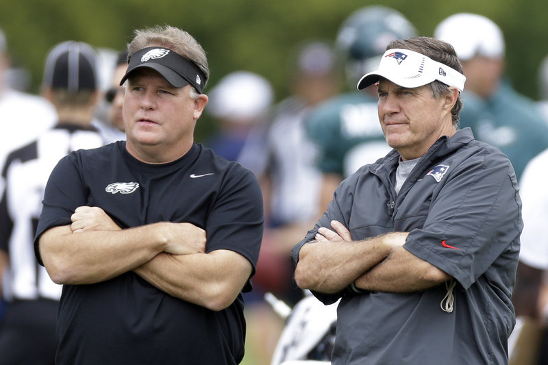 New Eagles coach Chip Kelly, left, and Patriots Coach Bill Belichick meet at a joint workout on Wednesday in Philadelphia. The teams play Friday night.