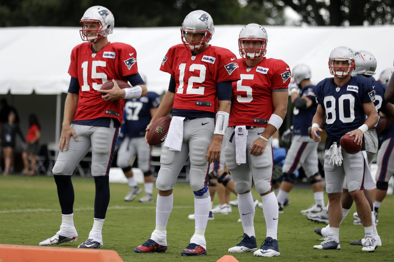 The Patriots are set at QB with Tom Brady, 12, who has backups Ryan Mallett, left, and Tim Tebow. They wait on Wednesday to run a drill during a joint workout with the Eagles in Philadelphia.