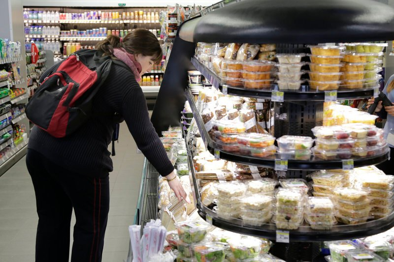 A customer shops for a sandwich in the Walgreens flagship store in the Empire State Building in New York.